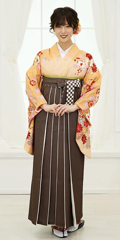 【着物】オレンジにラメ桜ぼかし+【袴】チャイロライン紐市松